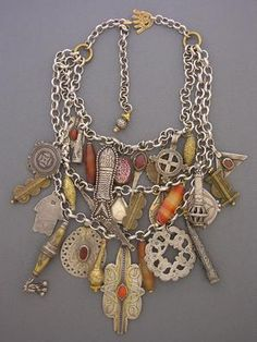 An amazing collection of antique pendants and amulets from the deserts  of the Middle East, to Europe, and through Africa.