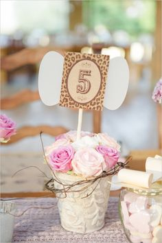 Potted flower table number ideas with a hint of cheetah print. Captured By: Carolien + Ben Photography http://www.weddingchicks.com/2014/05/22/rustic-dreamy-dutch-wedding/