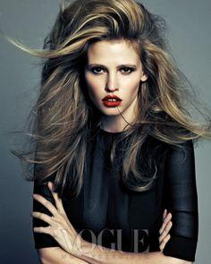 Voluminous hair.    Lara Stone for Vogue Korea, August 2012. Shot by Hong Jang Hyun.