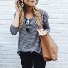 Comfy and casual - the striped tee is my favorite, and I like the dark jeans. Cute roomy tote, sunglasses & statement earrings, too!