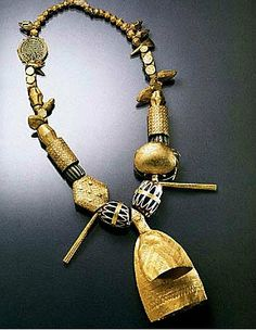 Africa | Necklace from the Asante people of Ghana.  Hollow gold (vary between 10.4 and 16.8 k) beads with a double bell focal point.  The antique chevron glass beads included in the necklace have also been decorated with gold.
