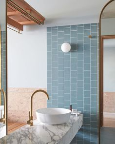 A private bathroom is decked out in swimming pool-blue tiles, marble and brushed brass. design blue The Calile Hotel in Brisbane is a design lover's dream Bad Inspiration, Bathroom Inspiration, Home Interior, Bathroom Interior, Luxury Interior, Bathroom Furniture, Contemporary Interior, Interior Ideas, Small Bathroom