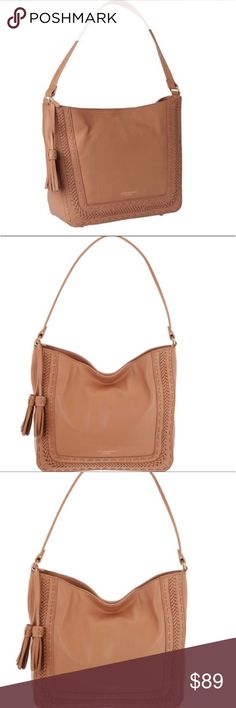 """NWT Tignanello Leather Hobo Purse Contrast-woven edges accentuate the lightly structured style of a smooth crafted leather hobo bag complete with a roomy interior. Single top handle. Top magnetic closure. Exterior features decorative tassel detail, front woven trim details, back zip pocket, logo accent, metal feet. Interior features wall zip pocket and 2 media pockets. 10"""" H x 14.5"""" W x 4"""" D. Approx. 10"""" handle drop. Brand: Tignanello Style: Shoulder Bag, Hobo Department: Women Material…"""