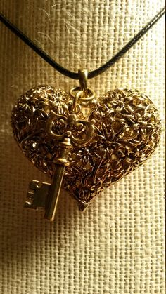 Lace Heart and Key Charm Necklace. Gold plated Lace Heart/ Gold plated skeleton Key This is a custom piece, One of a Kind!  Pendant is approximately 1 inch long x an 1 1/2 inches wide it includes an 18 inch black wax leather necklace.  As always more pictures available if wanted, just email me..  Thank you for visiting our shop! Debra