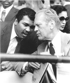 Gerald ford listens to Muhammad Ali with an attentive ear.
