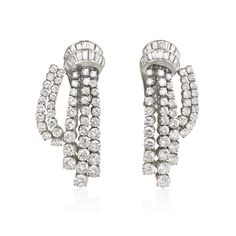 """A pair of Retro diamond """"Cascade"""" earrings design as two scrolls of baguette diamonds suspending three rows of articulated brilliant cuts and swag of diamonds, in platinum. Van Cleef & Arpels, Paris. indistinct numbers ?33?? Atw. 10.00 ct. round brilliant and baguette cut diamonds.  Circa 1949"""