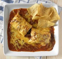Chile Colorado Burritos      Ingredients:        * 1 1/2 to 2 pounds stew meat or other beef cubed (top sirloin is great)      * 1 large can mild enchilada sauce (19 oz.)      * 2 beef bouillon cubes      * 1/2 can refried beans (optional)      * 5-7 burrito size flour tortillas      * 1 cup or so of shredded cheddar cheese