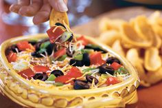 Make this spicy Mexican dip your go-to dip for tailgate parties. Just layer cream cheese, black bean dip and shredded cheese and top with your choice of onions, olives, and tomatoes.Recipe: Layered Spicy Black Bean Dip