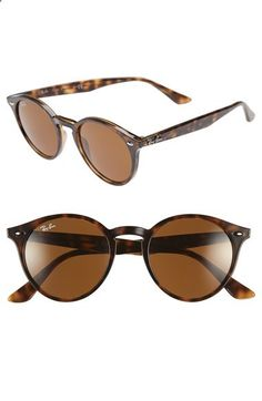 9bc04d6970 A polished, retro-inspired profile lends plenty of attitude to lightweight  Ray-Ban sunglasses with a flattened bridge and distinctive rivets.