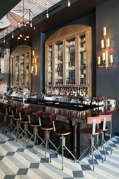 The sculptural vintage drafting stools provide the perfect statement piece at Wood and Vine Bar. By Kenneth Brown Design.