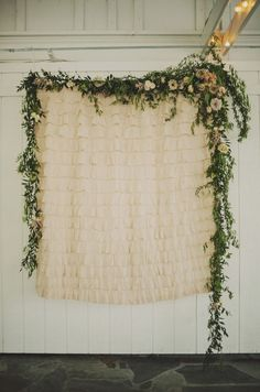Beautiful ruffled backdrop draped with fresh floral garland. Cedarwood | Cedarwood Weddings