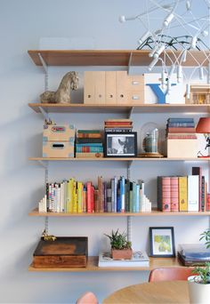 Mixing styled space and functional space is a must in smaller homes and apartments. Layer storage pieces in with books and personal items.