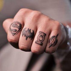 Superheroes finger tattoos