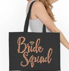 This roomy 100% organic cotton canvas tote bag is perfect for the Bride Squad. Large enough to carry any Wedding needs, this tote says BRIDE SQUAD in multi-faceted metallic rose gold rhinestuds accented with a rose gold glitter diamond. Fill the tote with goodies and give as a fun bridal Party Gift! Diamond Glitter, Rose Gold Glitter, Large Tote, Canvas Tote Bags, Cotton Canvas, Squad, Organic Cotton, Metallic, Team Bride
