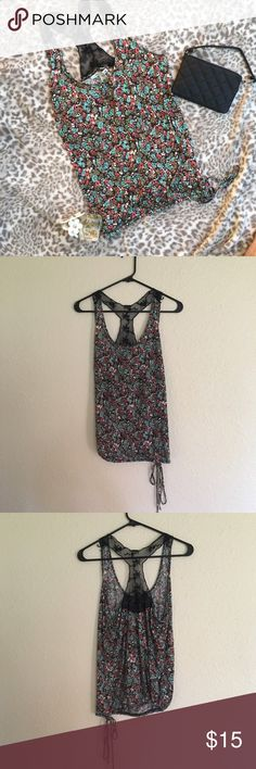 🌼 American Rag Floral Lace Racerback Tank Super cute tank top with lace detail on the back. Has a loose fit with an adjustable bottom to make the bottom looser or tighter to your preference. EUC with no visible flaws or defects.   Measurements are approximate & taken while laying flat: Chest 15in, Length 22in  ⭐️Sorry I don't do any trades.  ⭐️ I'm always open to reasonable offers.  ⭐️ Bundle your likes for an exclusive offer! American Rag Tops Tank Tops