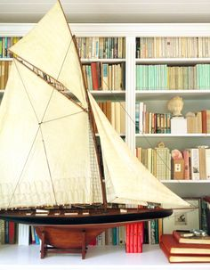 Nautical touches are necessary in any island inspired home decor. @Blue Hicks ' large scale model ship made a big and beautiful impact.