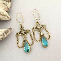 These Victorian inspired dangle earrings are a Downton Abbey style - lightweight and easy to wear with repurposed filigree connectors and graceful draping chain sections. Dangling in the center are gorgeous aqua blue rhinestone drops - vintage from the Art Nouveau era - oh so pretty! Measures 2 3/8 in length by 7/8 across. Ready to ship! This gorgeous brooch will arrive in a jewelry box - suitable for gift giving - within a few days following your purchase.  You dont have to worry a...