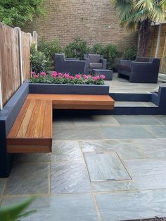 Modern garden design London natural sandstone paving patio design hardwood floating bench grey block render brick raised beds architectural planting Balham Chelsea Fulham Battersea Clapham Contact anewgarden for more information