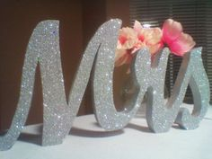 Mr & Mrs sign do the Mr sign in black. Modge podge and glitter. Finished with a coat of sealant. I will be Doing this.
