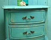 Love the color and drawer handles on this