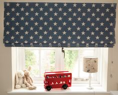 "Blackout interlined roman blind handmade by Victoria Clark Interiors using Sarah Hardaker ""Stars"" fabric.  Lampshade also handmade by Victoria Clark Interiors in Peony & Sage ""Best Friends"" fabric."