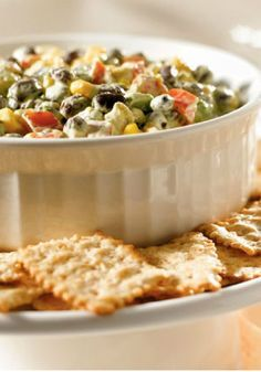 Southwest Avocado Bean Dip – Nibble on this—avocados, beans, corn, and cilantro in a chunky Tex-Mex dip. This game day appetizer recipe is full of big and bold flavor.