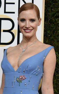 Jessica Chastain charmed in a low-cut powder blue Prada dress last night, which hugged every inch of the red-head's ample figure.