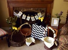 Fireplace area was set up with large baskets, ribbon and liners in bee theme and colors for guests to drop off wrapped items for gift exchange finale of My Favorite Things party.