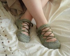 Elven Slippers.  The slippers are knit from the toe up with picots at the top of the foot and cuff, and a lovely lace leaf pattern on either side of the instep. Leafy i-cord laces keep them securely on your feet, or wear them plain.