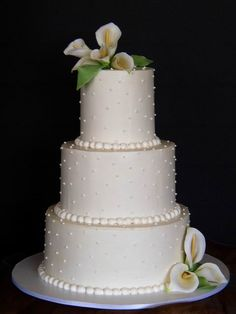 Martha Stewart's Wedding Cake Gallery - this is a great way to make pretty calas look attractive on a cake :))