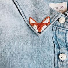 no sew shirts These fox collar shirts are the sweetest accent to an outfit. Hand embroidered on a soft, high quality chambray long sleeved shirt, let these small orange foxes peek out ove Embroidery On Clothes, Shirt Embroidery, Embroidered Clothes, Hand Embroidery Designs, Cross Stitch Embroidery, Embroidery Patterns, Jeans With Embroidery, Diy Embroidered Jeans, Baby Embroidery
