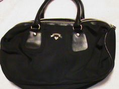 'Victoria's Secret Handbag Solid Black with logo' is going up for auction at  5pm Mon, May 20 with a starting bid of $4.