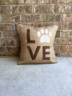 This pawprint love burlap pillow is inspired by my sweet dogs and is perfect for anyone who loves their dog! Font is done in dark chocolate brown