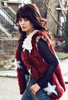 Aishwarya Rai for Vogue India March 2015 | Ash is wearing a fur vest by Tommy Hilfiger and a blouse by Saint Laurent and Gucci jeans.