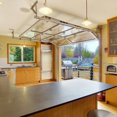 Cottage Industrial home. garage converted into the kitchen, garage door opens to the deck, awesome