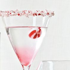 Candy Cane Martini //-- 1 1/4 ounces vanilla vodka / 1 1/4 ounces white crème de cacao / 3/4 ounce peppermint schnapps / peppermint candy // Combine vanilla vodka, white creme de cacao, and peppermint schnapps in an ice-filled cocktail shaker. Shake vigorously, and strain into a cocktail glass. Garnish with peppermint candy.