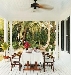 Another design of India Hicks - luncheon al fresco. I want to be there NOW. Love the palms best of course, but those chairs are almost as beautiful. #outdoor spaces #India Hicks #islands