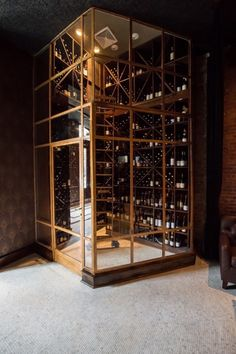 An Australian-designed 1920s-inspired restaurant in New York: A brass wine room in the main dining area.