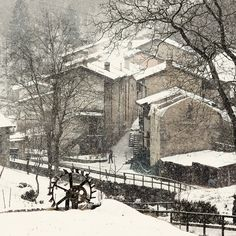 peaceful snow scene: pretty brick buildings