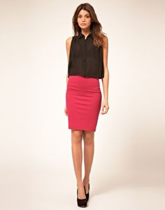 pink pencil skirt with a black blouse