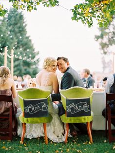 The most adorable chalkboard chair treatments. Photo by Ryan Ray Photography. www.wedsociety.com #wedding #chairs