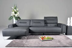 modern minimalist living room idea modern sectional with dark leather finishing adjustable back cushion additional facing chaise solid black side table silver vase of Be Simple yet Modern with These Black and White Living Room Sets Sofas For Small Spaces, Small Living Rooms, Living Room Sets, Corner Sectional Sofa, Modern Sectional, Sectional Sofas, Leather Sectional, Sofa Sofa, Buy Sofa