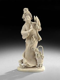 """Japanese Ivory Carving, 19th century, depicting the figure of a woman with flowers, h. 5-1/2""""."""