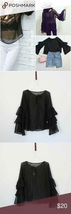 Alicia Sheer Dot Top in Black Details: Billowy sheer top with tiered long sleeves, tie neckline and textured polka dots  Brand: Boutique Brand  Size: Medium Measurements: Bust/34-36 inches  Length/22 inches  Size: Large Measurements: Bust/36-38 inches Length/23 inches  Condition: New and packaged with boutique tags Tops