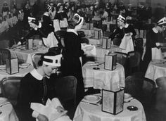 Lyons' Nippy waitresses at work in a Lyons tea room