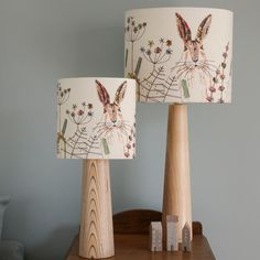 This lampshade features my popular hare design and is a high-quality print of the original hare textile piece. This is a beautiful way to bring a little bit of nature into your home and it produces a lovely glow when illuminated.