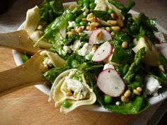 20 Spring Salads! This one has fresh spinach, asparagus, tortellini, peas, pine nuts, garlic goat cheese and homemade dressing - http://www.thekitchn.com/recipe-pasta-lite-salad-84429   mjb