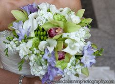 Hand-Tied Bouquet Featuring Cymbidium and Dendrobium Orchids from Unique Floral Expressions