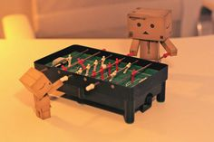 This image reminds me of FRIENDS 'Joey and Bing playing Foosball'