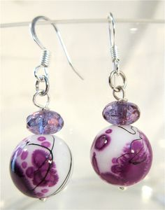 Purple white and black bead earrings. $14.00, via Etsy.